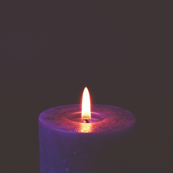 Photo of a burning candle that can accompany with Dark Moon Meditation