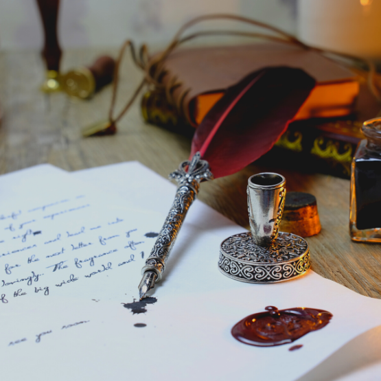 photo of a quill and a piece of paper great for new moon affirmations