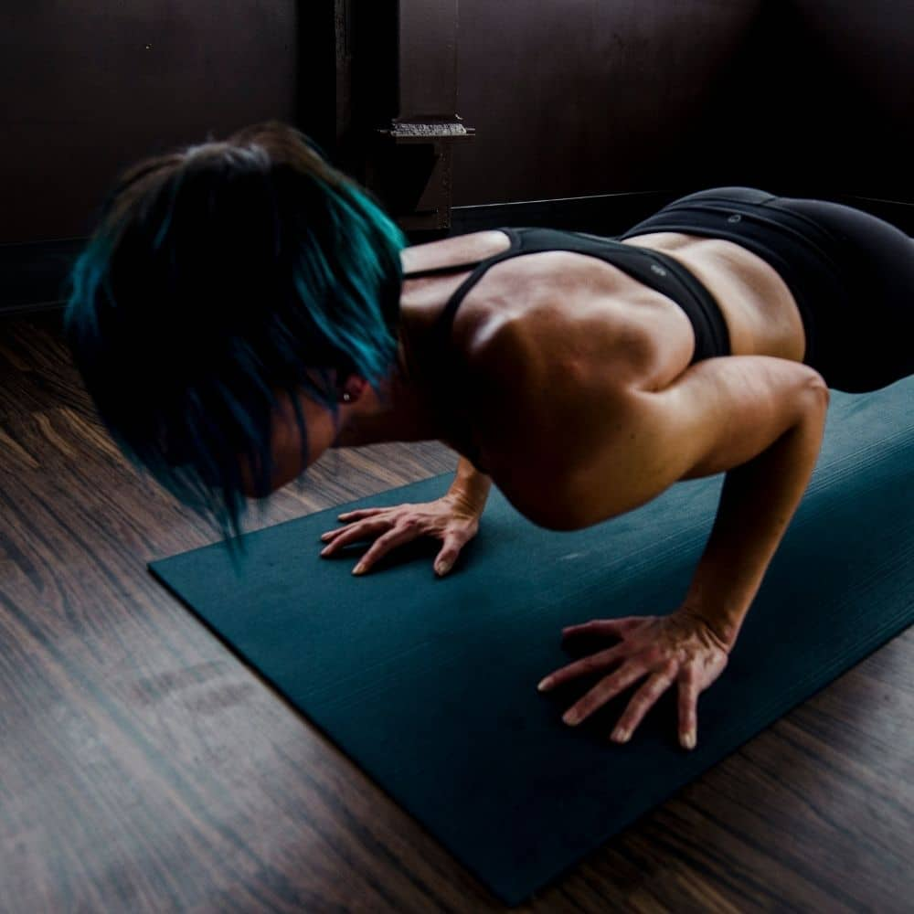Photo of a lady doing a push-up
