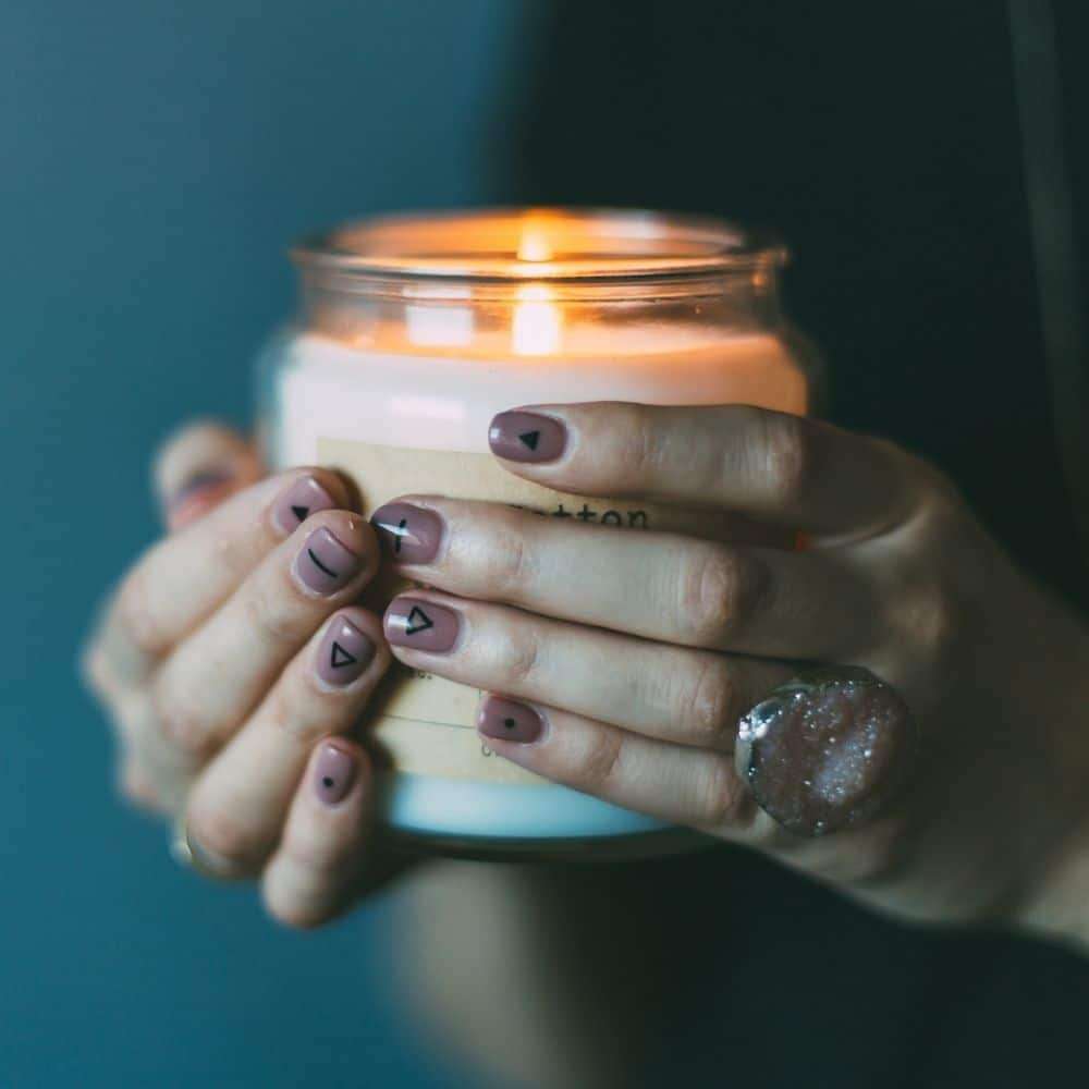 photo of a person holding magical candle