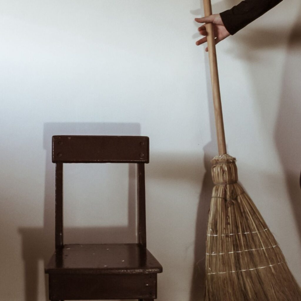 photo of a broom and a chair