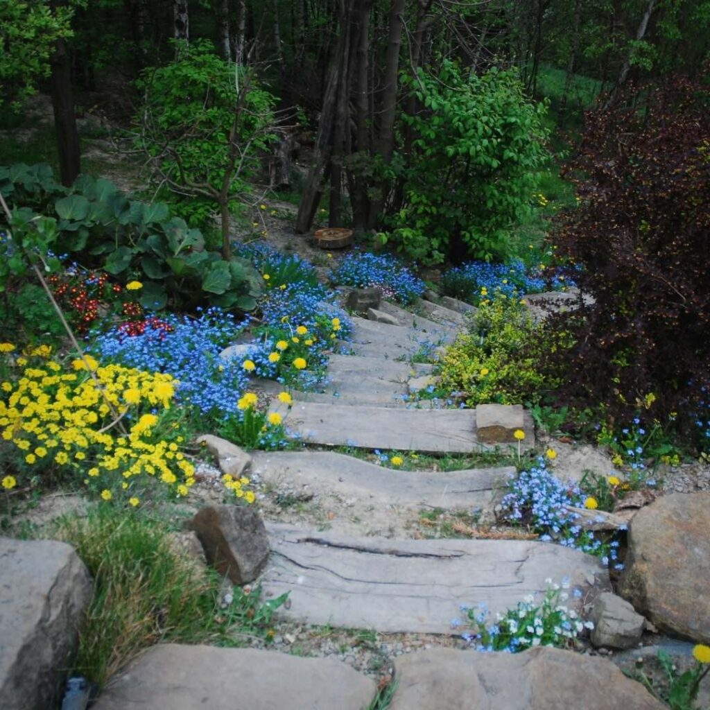 photo of a beautiful spring time stairs full of blooming flowers