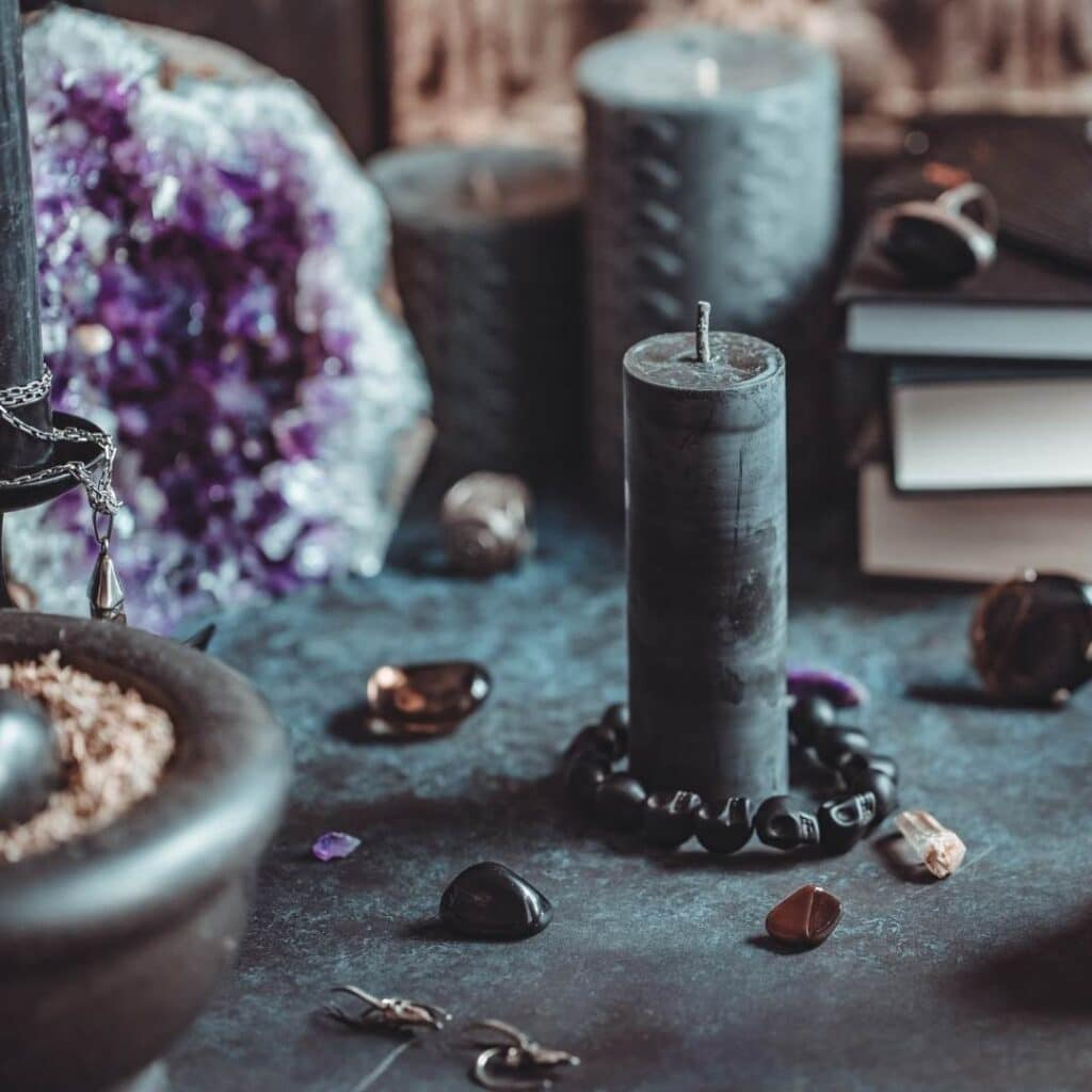 photo of a hedge witch altar with crystal and candle
