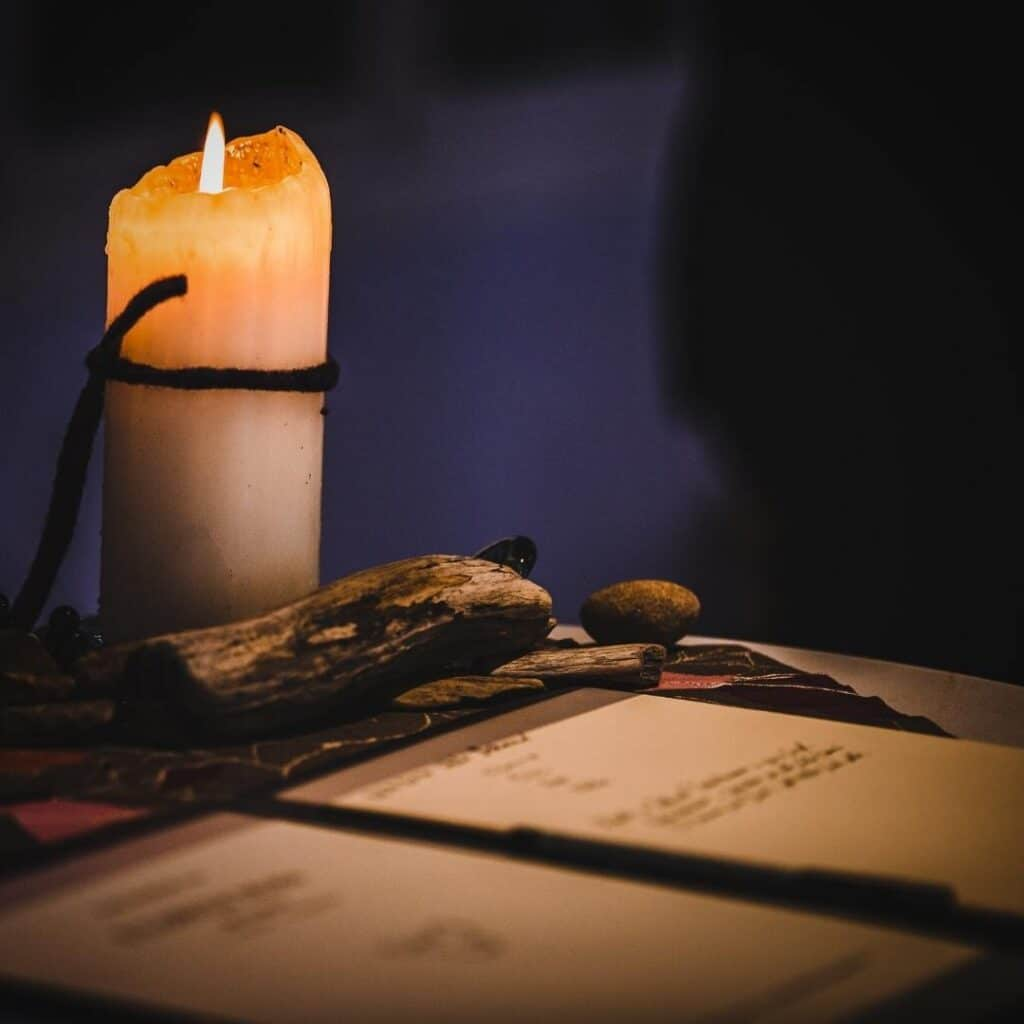 photo of a candle and book