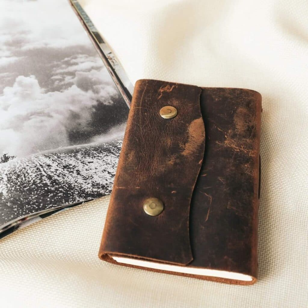 Photo of an old fashion leather journal - setting goals is one of the Ostara rituals