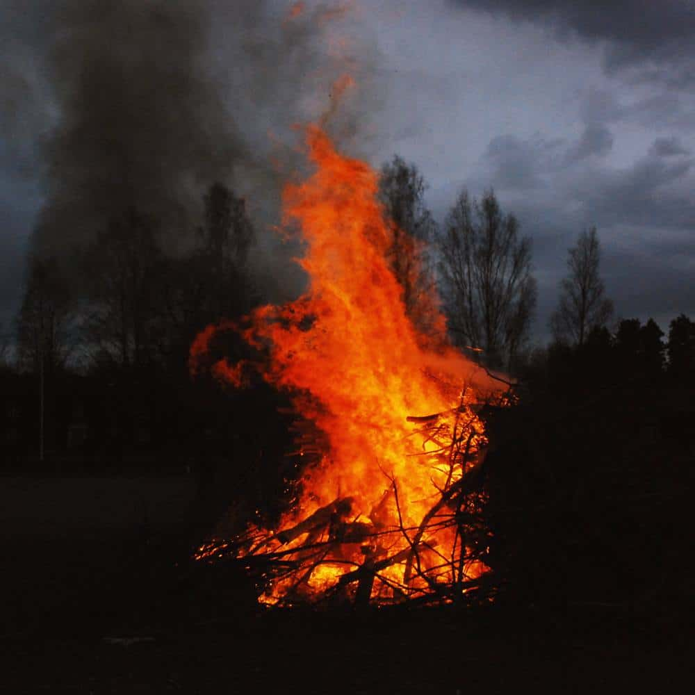 photo of celebrating summer solstice rituals for litha and midsummer with a bonfire