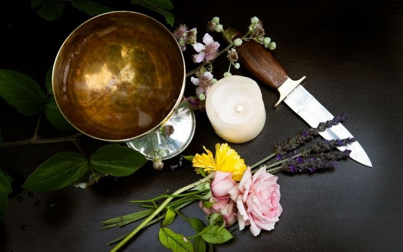 photo of chalice and athame - essential witch ingredients